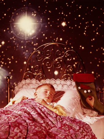 Little Boy Sleeping in Brass Bed With Christmas Stocking and Starry Dream Images
