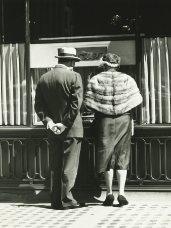 Man and Woman Looking at Window Display in Retail Store, Rear View