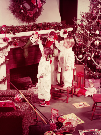 Two Girls in Pyjamas, Taking Dolls Out of Stockings on Christmas Morning