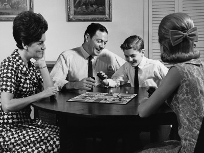 Family Playing Board Game at Table