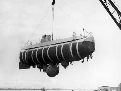 Bathyscaphe Trieste Being Loaded Aboard the USS Point Defiance by Floating Crane