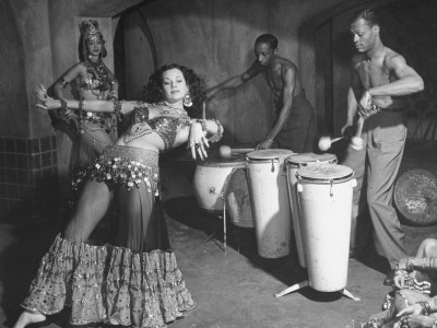 "Sylvia Operte Belly Dancing as Drummers Accompany Her in Scene from Film ""Desert Song"""