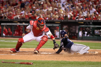 Brewers v St. Louis Cardinals - G. Four - Oct. 13: Jerry Hairston Jr. and Yadier Molina