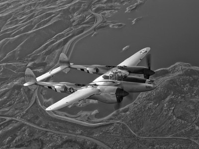 A Lockheed P-38 Lightning Fighter Aircraft in Flight Photographic Print