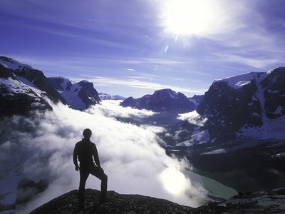 A Lone Climber Enjoys the View Above the Clouds