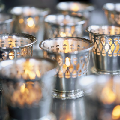 Many Votive Candles in Silver Holders