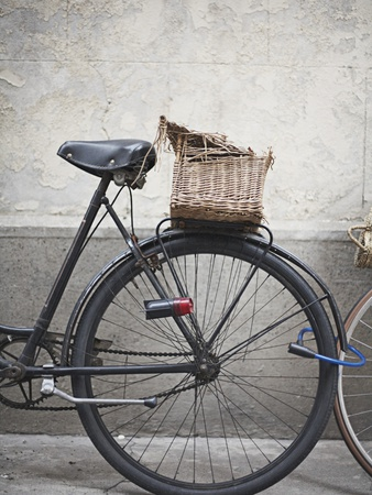 Bicycle with weathered basket Posters