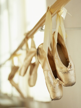 Ballerina Shoes Dangling from Bar