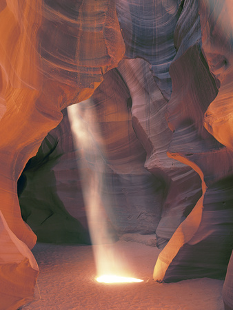 Sunbeam Illuminates Sandy Floor and Sandstone Walls of a Slot Canyon, Antelope Canyon, Page