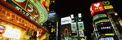 Low Angle View of Buildings Lit Up at Night, Shinjuku Ward, Tokyo Prefecture, Kanto Region, Japan