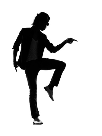 Full Length Silhouette Of A Young Man Dancer Dancing Funky Hip Hop R And B..
