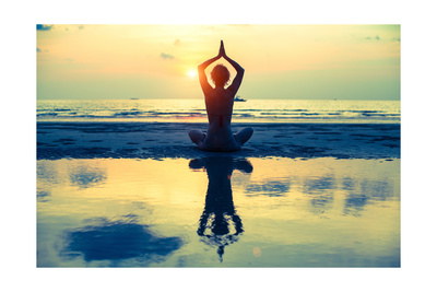 Yoga Woman Sitting In Lotus Pose On The Beach During Sunset