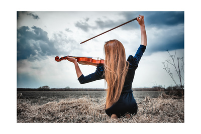 girl with vert long red hair, seen from back in tight fitting dark long sleeved dress, holding violin in playing position, Bow is in right hand arched over her head, tip pointing towards violin. She is on a lakeshore with dramatic clouds