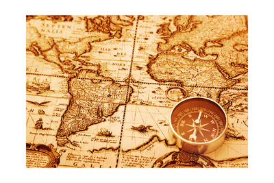sepia photograph, compass sits over southern part of Africa over old-style map