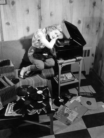 1950s Teenage Girl Listening To Music On A Phonograph..