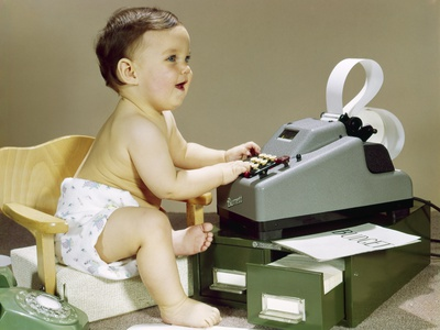 1960s Smiling Accountant Baby Wearing Cloth Diaper Sitting in Chair Using Adding Machine