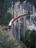 Passenger Train on Rock Bridge, Switzerland