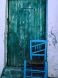 Chair in Front of a Green Door in the Village of Caceres, Caceres, Extremadura, Spain