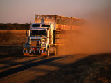 Road Train Driving along Dusty Road, Kynuna, Australia