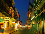 Flags Hanging Over the Empty Bourbon Street at Night, New Orleans, Louisiana, USA