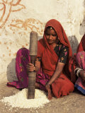 Woman Pounding Food in Village Near Deogarh, Rajasthan State, India