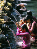Young Women at Tirta Empul Temple, Ubud Region, Island of Bali, Indonesia, Southeast Asia