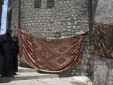 Local Woman Walking Down Steps, Blanket on Wall, Aleppo (Haleb), Syria, Middle East
