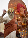 Holy Man in Front of a Ganesh Statue Draped in Fairy Lights at the Hindu Festival of Shivaratri