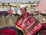 Man Selling Rugs on Banks of Kabul River, Central Kabul, Afghanistan