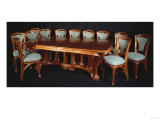 A Highly Important Carved Mahogany Dining Table and Chairs