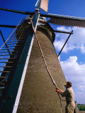 Miller Turning Sails to Stop Windmill in Kinderdijk, Zuid Holland, Netherlands