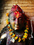 Deity with Garlands and Bindi Powder, Bhaktapur, Bagmati, Nepal