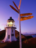 Signpost in Front of Lighthouse at Dawn, Cape Reinga, New Zealand
