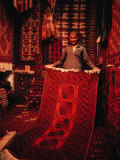 Carpet Trader Displaying a Woolen Carpet, Peshawar, North-West Frontier Province, Pakistan