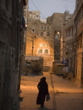 Woman Walking in Old Town, Dusk, San'a, Yemen