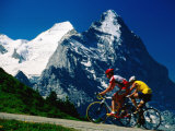 Cyclists in Front of Eiger and Snow-Covered Monch, Grosse Scheidegg, Grindelwald, Bern, Switzerland