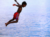 Boy Falling into Water, Lifou Island, Loyalty Islands, New Caledonia