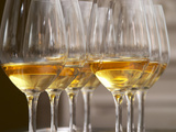 Wine Tasting Glasses with Golden Sweet White Wine from Uroulat Jurancon Charles Hours, France