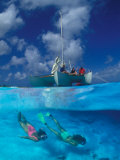 Female Divers Submerged Below Catamaran Photographic Print