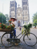 Woman Selling Flowers off Her Bicycle, Hanoi, Vietnam, Indochina, Asia