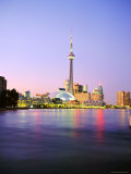 The Cn Tower Rises Above the City Skyline at Dusk, Toronto, Ontario, Canada
