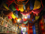 Brightly Dyed Wool Hanging from Roof of a Shop, Marrakech, Morrocco, North Africa, Africa
