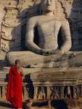 Monk in Front of the Seated Buddha Statue, Gol Vihara, Polonnaruwa, Sri Lanka, Asia