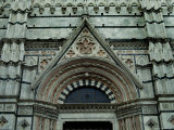 Close View of Top of One of the Portals to the Duomo di Siena, Tuscany, Italy