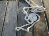 Dock Line Coiled on Pier Tied to Cleat, Ambergris Caye, Belize
