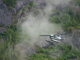 Float Plane against Granite Cliff, Alaska