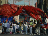Louisianans Revel Beneath a Giant Crayfish Mardi Gras Float, New Orleans