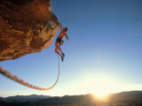 Rock Climber Dangling Off of Cliff Photographic Print