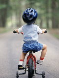 Little Boy Riding His Bicycle with Helmet