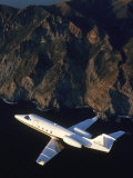 Lear Jet in Flight Over Mountains